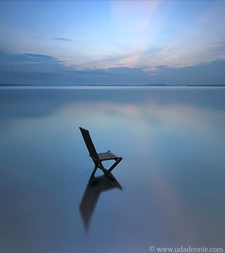 A single chair positioned in the water could be the best quiet place ever.