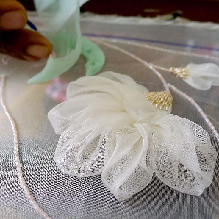 Adding leaves to the silk organza flower appliques design. #wip to perfect…