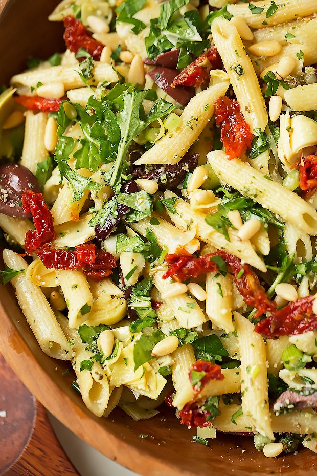 Copycat recipe for Cafe Express Pasta Amore. Mediterranean pasta salad is easy to make and loaded with artichokes, olives, sun-dried tomatoes, and capers.