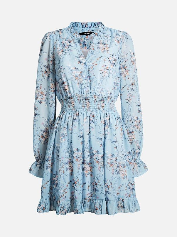 Vi har øynene våre på den feminine stilen akkurat nå, og denne kjolen synes vi har alt. Supersøt langermet chiffonkjole med rysjedetaljer og bred elastisk m Multi