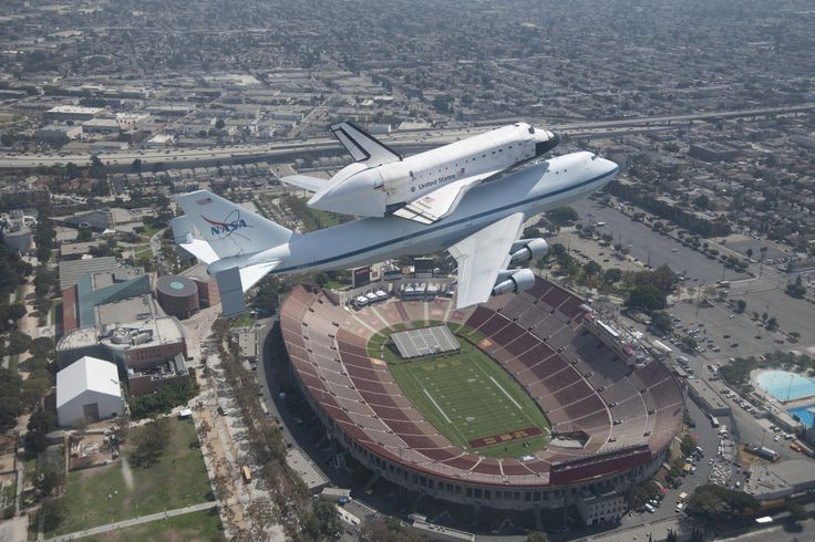 """Space shuttle Endeavour is seen flying over its new home at the California Science Center (CSC), Sept. 21, 2012. This photo, along with more than 80 others like it, are part of a new exhibit at the CSC chronicling """"Mission 26: The Big Endeavour."""" Credit: NASA/Jim Ross"""