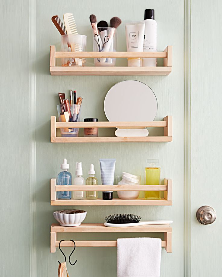 Instant Upgrades: Easy Organizing Ideas to Spruce Up Your Space | Here's a space-saving solution that's worth its salt (and pepper): Cut down on morning bathroom time and carve out a quiet space just for you by mounting spice racks on the back of a closet door to corral your beauty essentials. Behold: your very own stress-free dressing station, with no one knocking to come in.  #homedecor #homeorganization #marthastewart