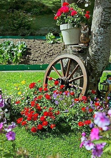 Wagon Wheel idea, maybe with geraniums.