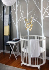 Love the gray walls with yellow accent...that round crib looks like it belongs to a tiny baby.
