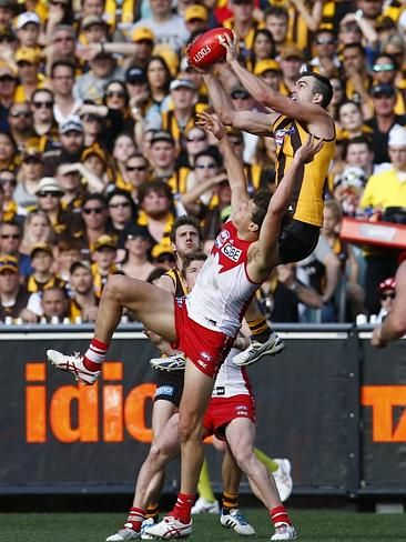 2014 AFL grand final | Herald Sun | Brian Lake takes a spectacular mark over Kurt Tippett. Picture: Michael Klein