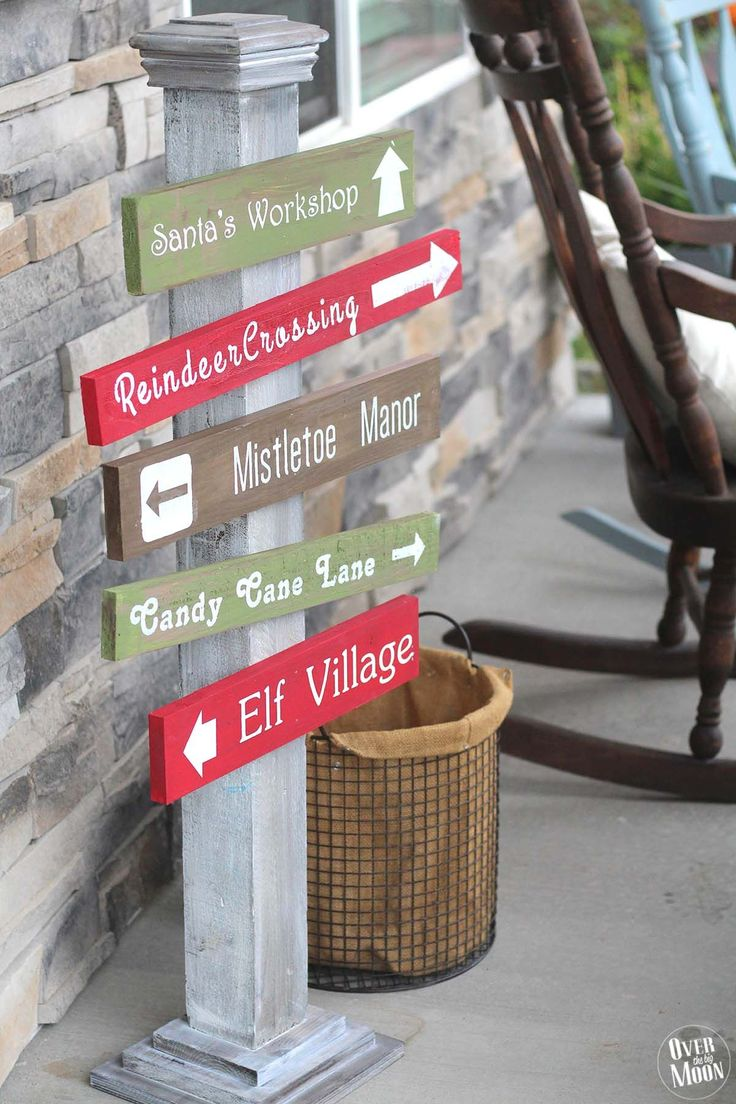 DIY North Pole Sign- learn how to make this adorable sign to sit on your porch for Christmas from Over the Big Moon for www.thrityhandmadedays.com