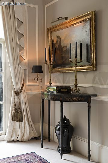 """a lovely corner: cotton damask curtains by Ian Sanderson, a pair of ormolu candelabra, an 18th C. console, Farrow and Ball """"Stony Ground """" wall colour."""