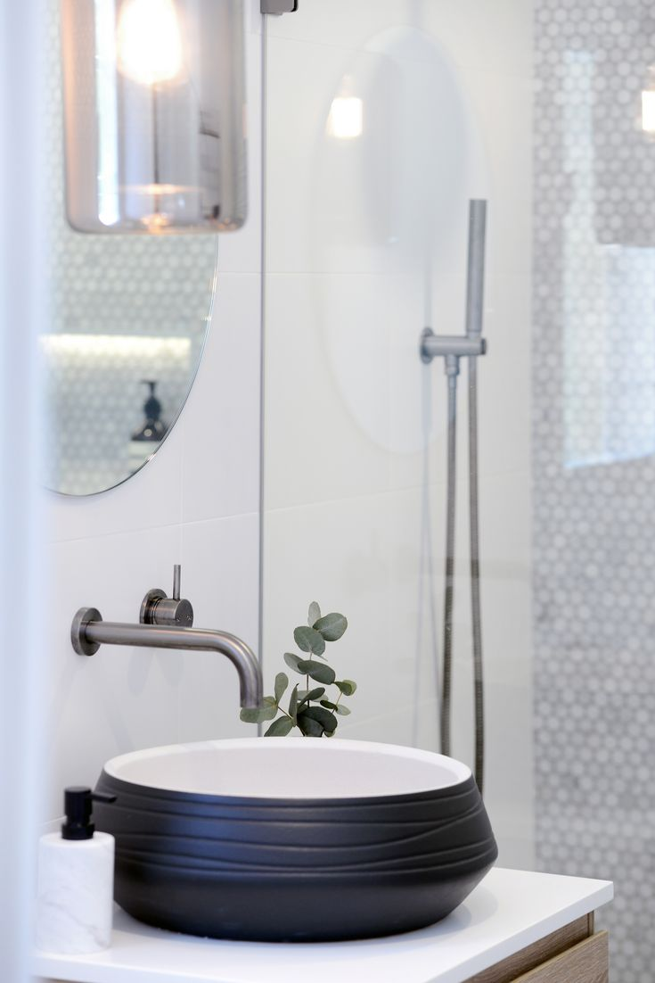 Timeless and elegant bathroom with carrara feature tile designed by Alix Helps Interiors