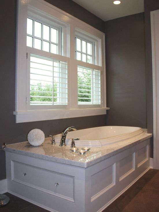 Vinyl shutters are great to use in the bathroom.  This cafe style also highlights the detail at the top of the window, nice!