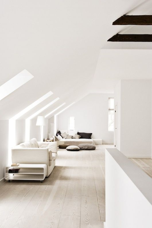 I love all these white walls and the light filtering in from the windows. And the angled ceiling.