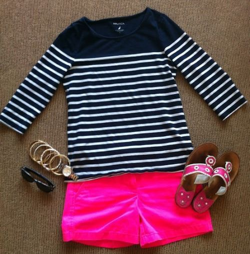 Black-and-white striped shirt with pink shorts.