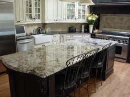 cambria praa sands quartz countertop. Black island. White cupboards. This is almost exactly my new kitchen-to-be!