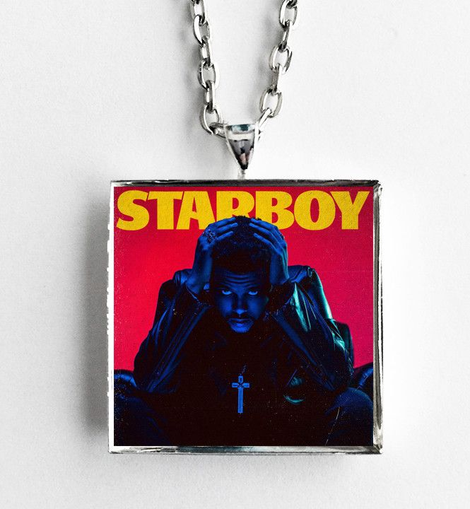 "This is a necklace featuring album art of the ""Starboy"" record by The Weeknd sealed in a silvertone metal setting. The album cover pendant is 1"" and on a 20"" long silvertone neck chain. The necklace i"