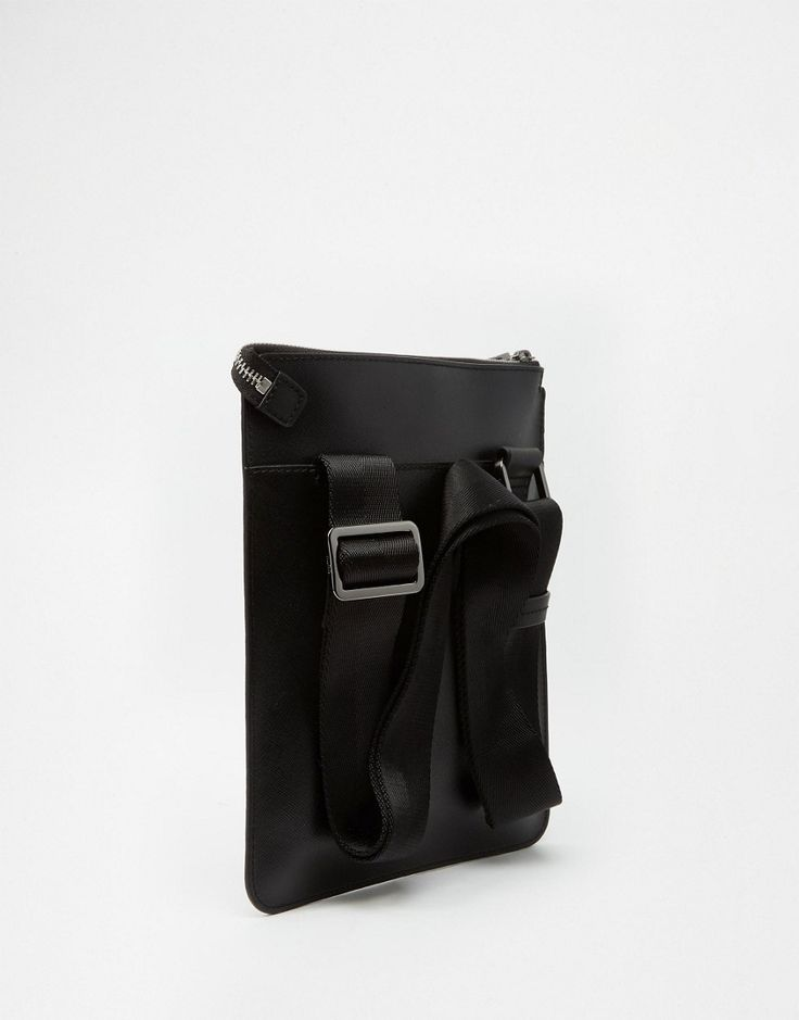 Strap fastened on the back, more practical as strap doesn't get in the way when opening the bag.