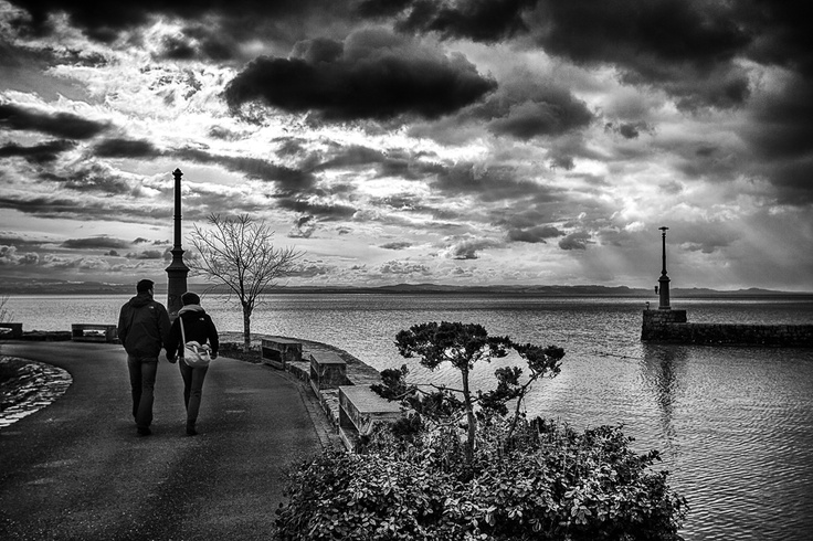 Couple walking along the harbour