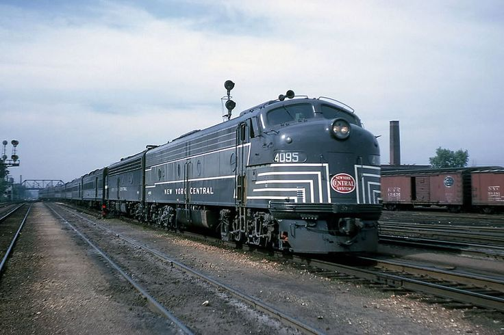 New York Central EMD E8 - Englewood Station, Illinois, June 07, 1962 - New York Central's last E8 unit is paired with another black one on the front of the combined PACEMAKER / NEW ENGLAND STATES as it slows for Englewood station.