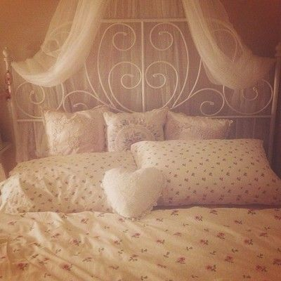 I love the Ikea Leirvik bed. Feminine and cute.