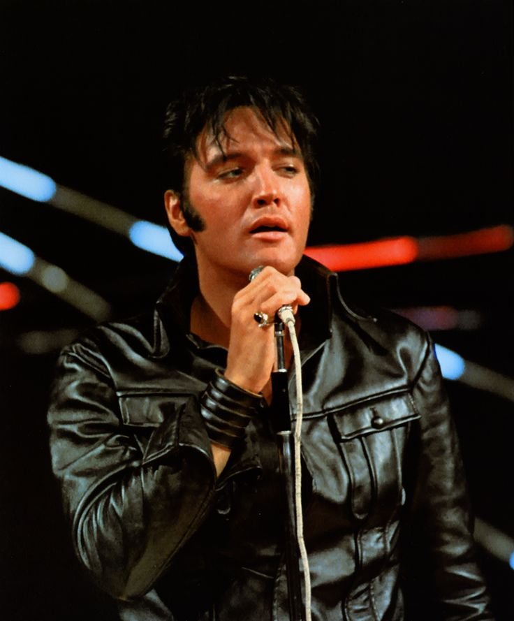 """Elvis during the """"Stand-up/Leather Suit""""  segment of his NBC-TV ' ~ 68 Comeback Special; directed by Steve Binder, on June 29, 1968."""