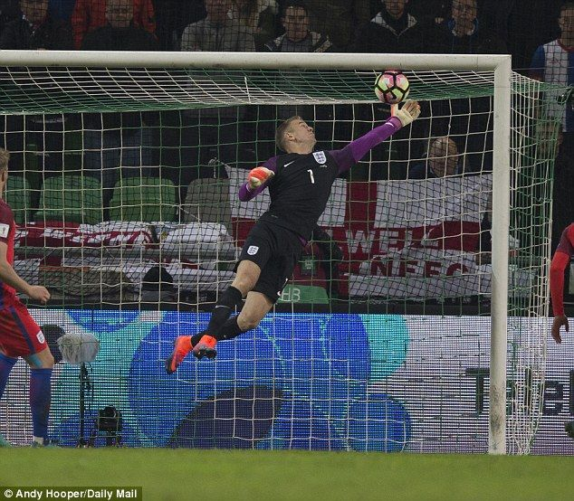 England goalkeeper Joe Hart makes an excellent save against Slovenia in a World Cup qualifier October 2016