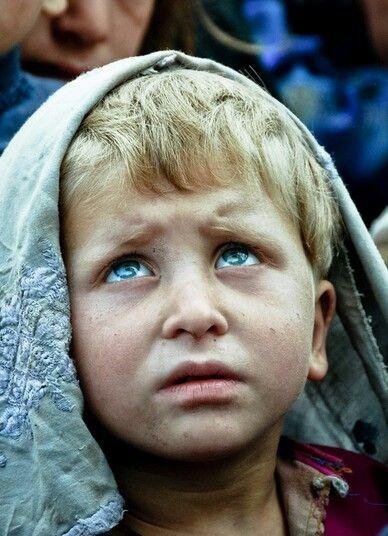Afghanistan boy look at color of light blue eyes ...