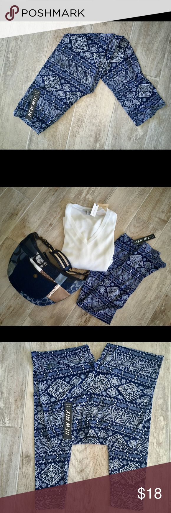 Blue and White Print Leggings Wardrobe staple, blue and white leggings look great with anything from a chunky white sweater to a Blouse or tank top and jacket with boots Pants Leggings