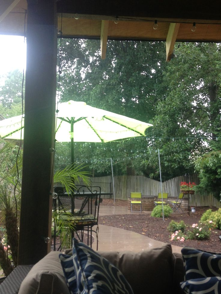 Rainy afternoon under the covered pergola .