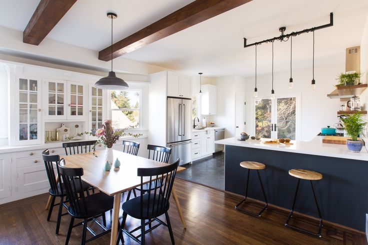 """""""Ultimately we got over the fear and pulled the trigger on removing some of the crown moulding in the living room, painting some select baseboards and built-ins and then refinishing/staining some of the trim. We love the end result and are amazed at how much bigger and modern that half of the house feels without taking away any of the original charm."""""""