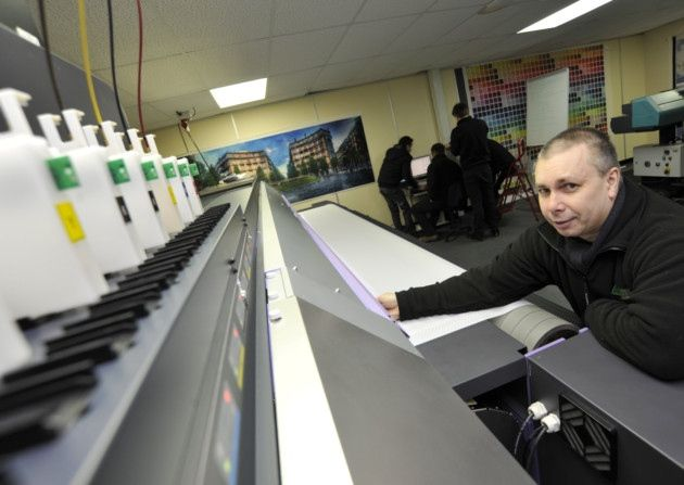 House of Flags, in Kimbolton, have a new state of the art printer, Print Operative Stephen Hall making some adjustments