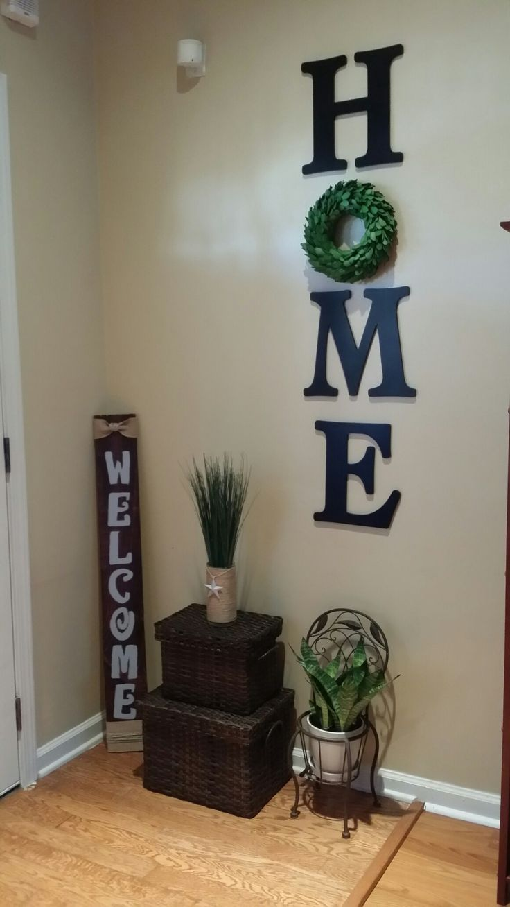 Wood letters HOME with wreath wall decor. Diy living