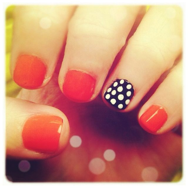 For those of you with short nails, try doing black + white polka dots on just one nail! bright orange or pink on all the others!