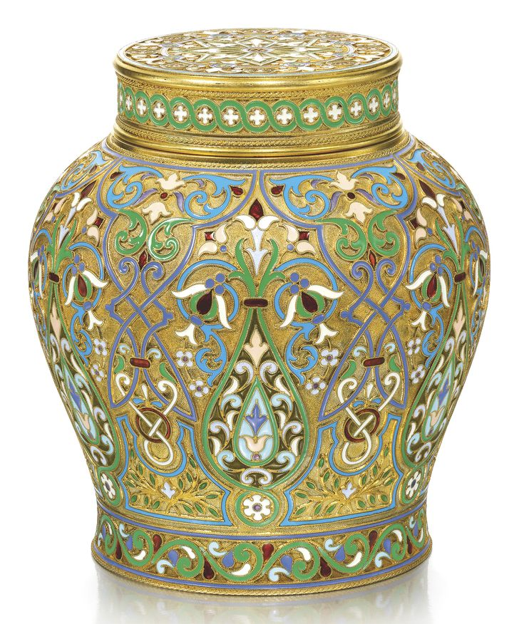 A SILVER-GILT AND CLOISONNÉ ENAMEL TEA CADDY, KHLEBNIKOV, MOSCOW, 1899-1908     baluster form, the surface with polychrome bandwork, lobes and foliage on stippled grounds within scroll and entrelac borders, the interior of the lid engraved with initials GK, silver-gilt-mounted cork stopper, 88 standard, scratched inventory number 2456/ C