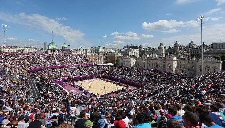 Sights and sounds: The Olympic beach volleyball tournament kicked off yesterday in the historic heart of the UK capital. However, spectators' eyes were firmly fixed upon the athletes and their toned bodies