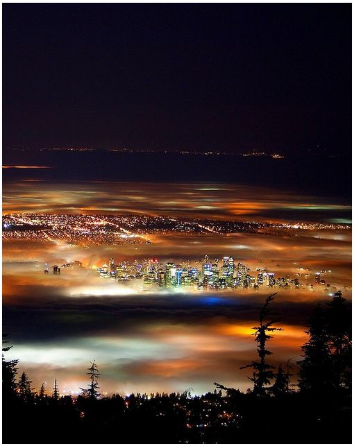 Vancouver, BC, Canada at night (with fog) taken from the higher up areas of North Vancouver