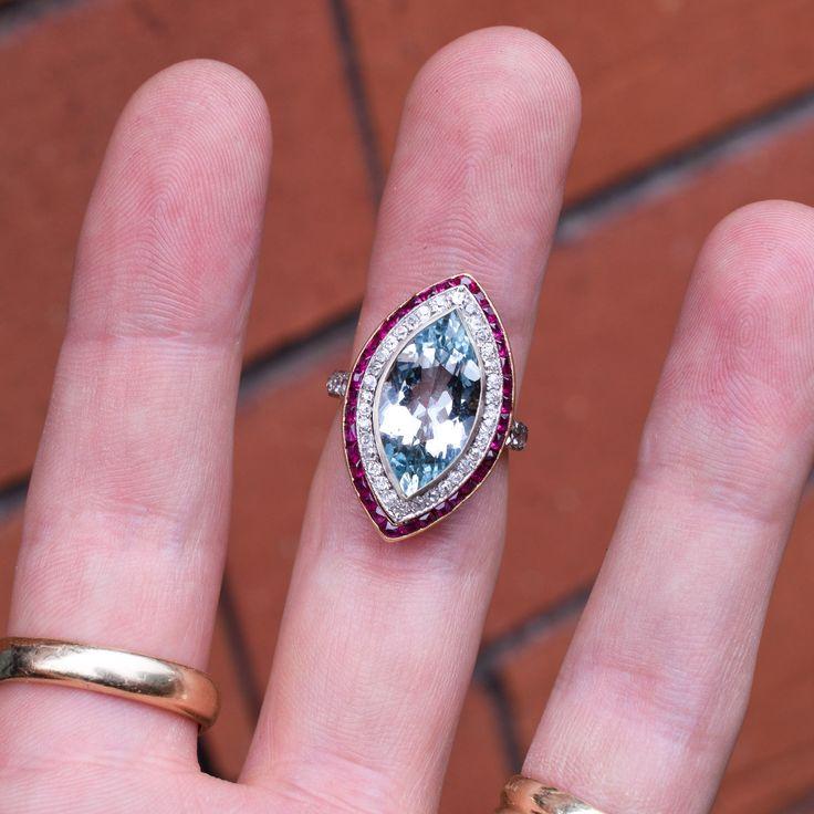 A stunning Edwardian Aquamarine Marquise Halo Ring, dating to c.1910