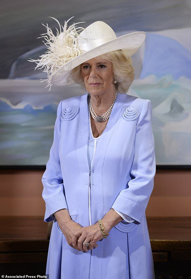 Camilla Duchess of Cornwall looks on as Prince Charles receives the Extraordinary Companion to the Order of Canada medal from Governor General David Johnston at Rideau Hall in Ottawa on Saturday, July 1, 2017. (Adrian Wyld/The Canadian Press via AP)