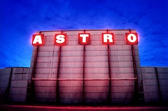Astro Drive-In movie theater opened in Dallas in 1968 becoming the world's first fully automated drive-in, known for having the largest screen in the Western Hemisphere. The screen measured nine stories tall and was 140 feet wide.    Until it was destroyed by fire on the night before Thanksgiving in 1998, the Astro Drive-In was the last operating drive-in theater in the Dallas/Fort Worth area until 2004 when Galaxy Drive-in opened in rural Ennis, Texas.