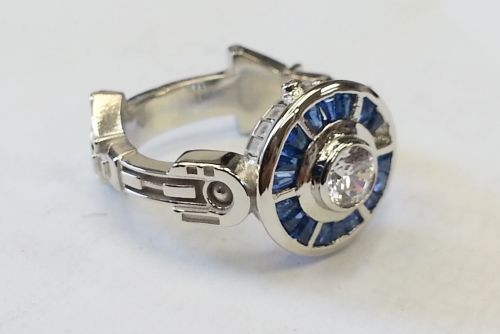 R2D2 Engagement Ring: Is this the ring you've been looking for? This R2D2 inspired ring designed by Paul Bierker is perfect for any Star Wars fan. Available in sterling or white gold with sapphire baguettes and diamonds in the gold and CZ in the sterling.  Price: $1,250-$2,950
