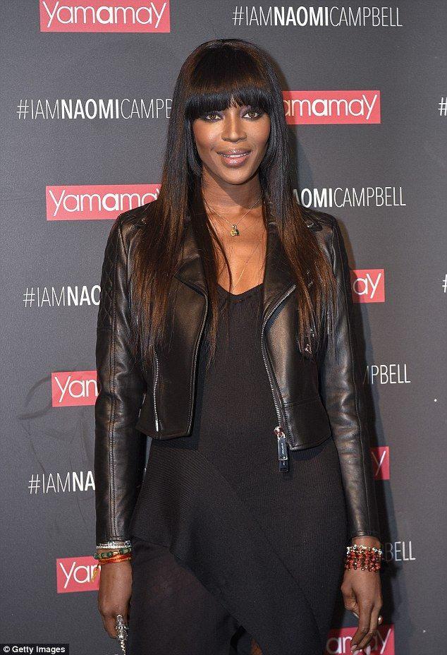 Always a professional: Posing up a storm, Naomi, 45, popped her hip to the side, emphasising her enviably toned pins which were given some extra height by the addition of a pair of platform peep top heels