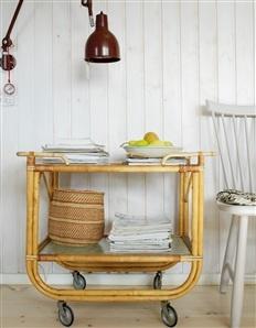 """Ärvd rullvagn. Korg, Afroart.  Stol """"Lilla Åland"""", design Carl Malmsten."""