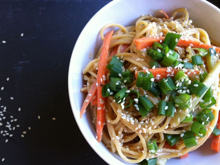 Cold sesame noodles: Cold Sesame Noodles mixes noodles, carrots and cucumbers with a delicious Asian sauce, topped with sesame seeds and green onions.