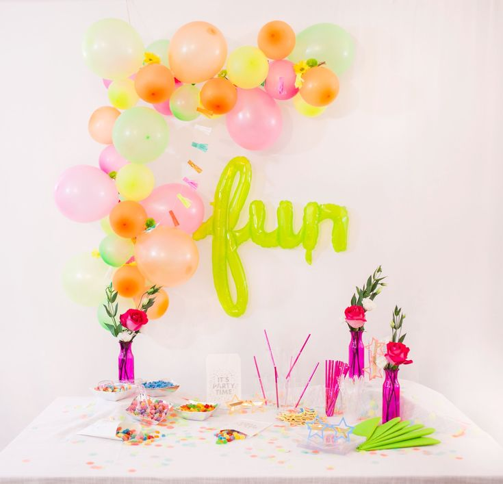 """FUN""- an awesome super large air-filled balloon surrounded by a beautiful DIY balloon garland."