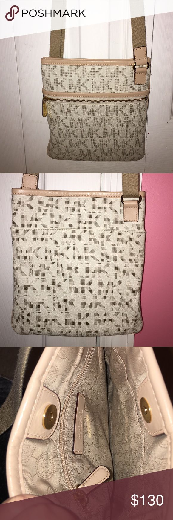 Michael Kors Large Crossbody Logo Bag In great condition and very spacious. I rarely used. It's just like brand new. MICHAEL Michael Kors Bags Crossbody Bags