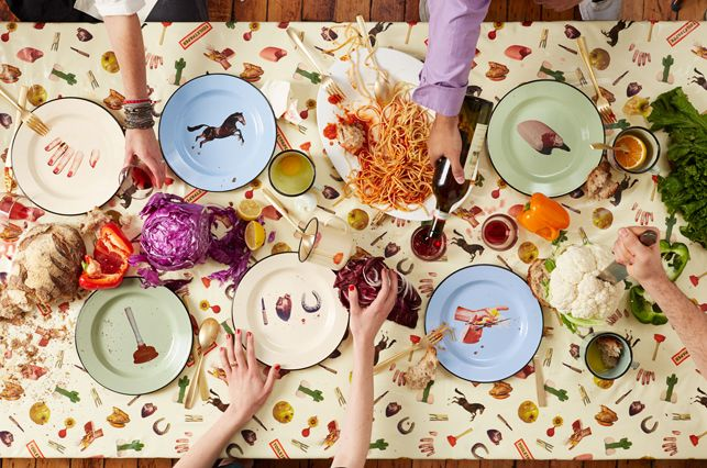 A scene from MoMA Design Store's spring catalog cover shoot featuring Seletti Wears Toiletpaper, a suite of dishes, mugs, and tablecloths created by Maurizio Cattelan and Pierpaolo Ferrari for Seletti
