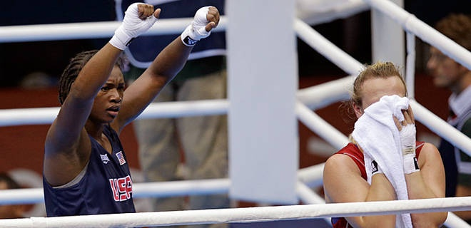 Shields advances to gold-medal bout...US boxer Claressa Shields, left, celebrates after defeating Kazakhstan's Marina Volnova.