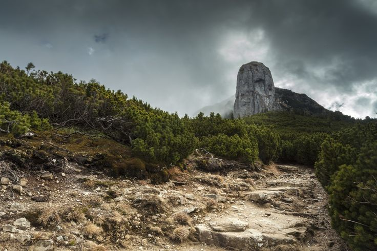 """None of Ceahlău's rocks lit the imagination of bards more than Dochia and Panaghia. The rock of Panaghia, located near of the """"blunted"""" top of Toaca, raises majestic and brilliant in sunlight. The sun still loves her and sends his caressing beams which surround her with an arm of amorous… It"""