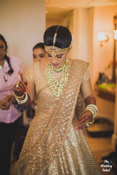 Layered polki jewellery , gold bridal lehenga , sabyasachi mukherjee lehenga…