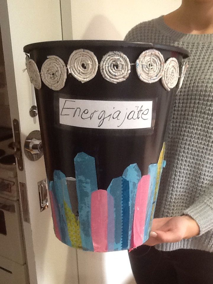 Waste basket. Redecorated with planstic bags and with wire wrapped by newspaper.