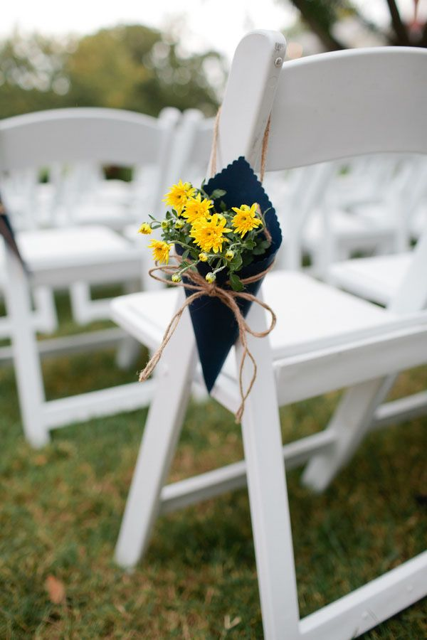 navy and yellow aisle floral decorations.