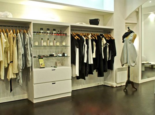 I love the design of this fashion boutique in Paris. The white shelving and hardwood floor add a classic element that makes the clothes appear even more sophisticated. The lighting above the clothes also works to add to this concept.