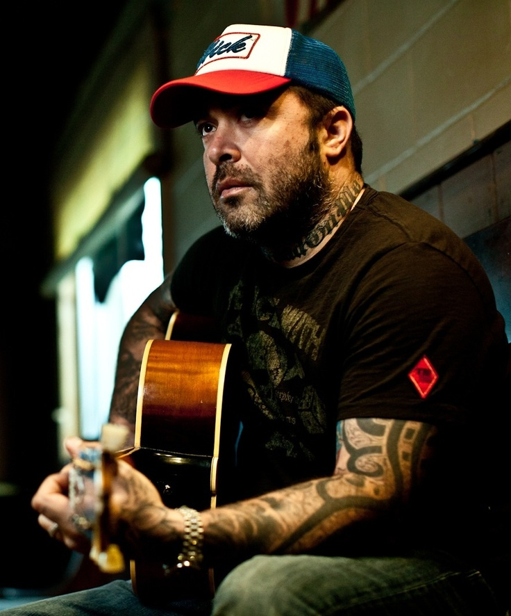 Aaron Lewis.  No one can make love to your ears with his voice quite like this man can..